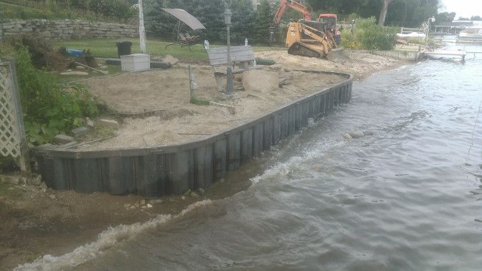 Seawall construction scene shows benefits of seawalls