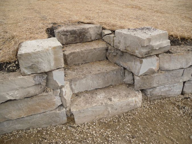 An image showing outcropping stones used as steps for a home.